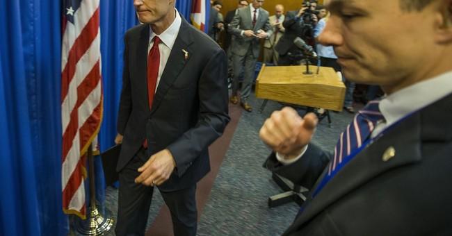 Florida Gov. Rick Scott Signs New Gun Bill Into Law