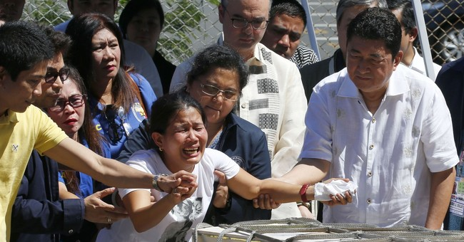 Slain Filipina in freezer shows risks to overseas workers