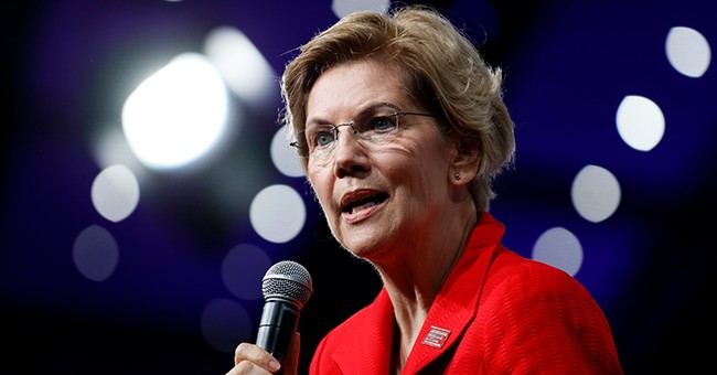 Rueful over heritage claim, Warren woos Native American vote