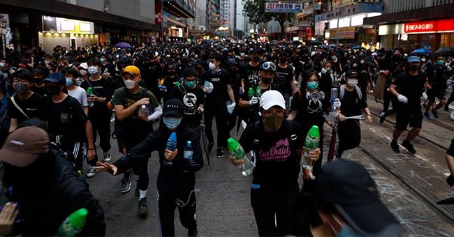 Hong Kong Protestors Reportedly Using Arrows When They Need Guns