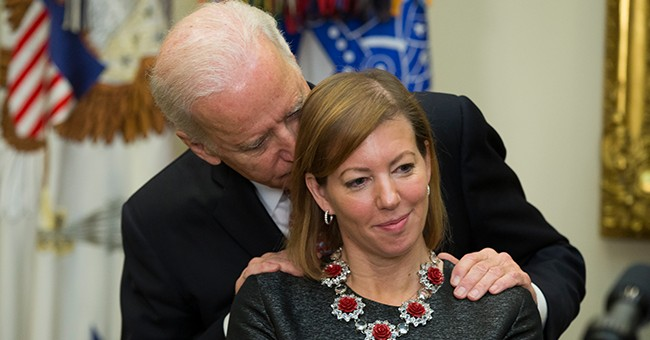 Image result for joe biden nuzzling hair