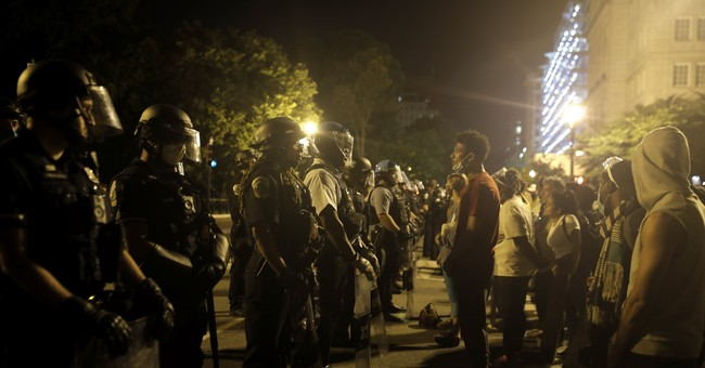 Media depiction of protesters and law enforcement/AP featured image