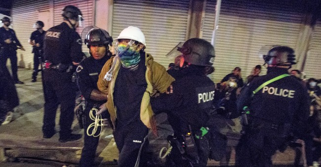 Rasmussen Poll Finds Most Voters Think Trump Sides with Police, Democrats with Protesters