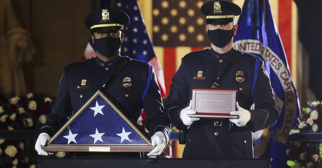 Capitol Police Officer Brian Sicknick's Body Arrives at the Capitol Rotunda