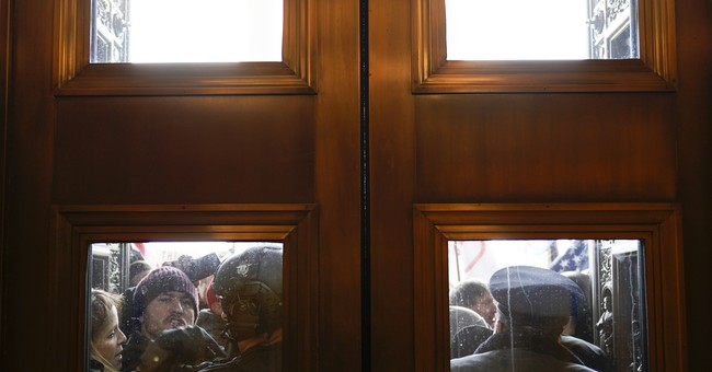 Video Shows Trump Supporters Attempting to Stop People from Breaking into the Capitol