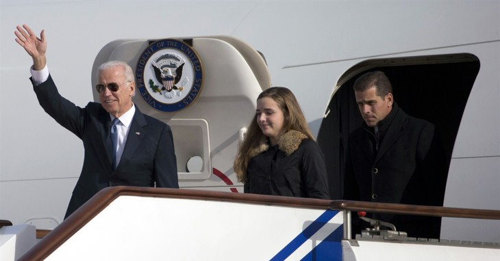 FILE - This Dec. 4, 2013, file photo shows U.S. Vice President Joe Biden, left, arriving on Air Force Two in Beijing, China, with his son Hunter Biden, right, and his granddaughter Finn