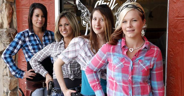 Waitresses Ashlee Saenz, left, Lauren Boebert, Jessie Spaulding, and Dusty Sheets pose for a photo with their sidearms in front of the Shooters Grill in Rifle, Colo., June 23, 2014. A
