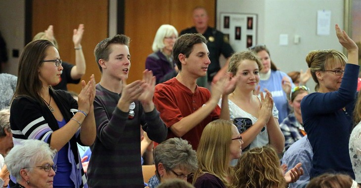 Students react while attending a Jefferson County School Board meeting, which saw several hours of testimony from members of the public weighing in on the school board's controversial p
