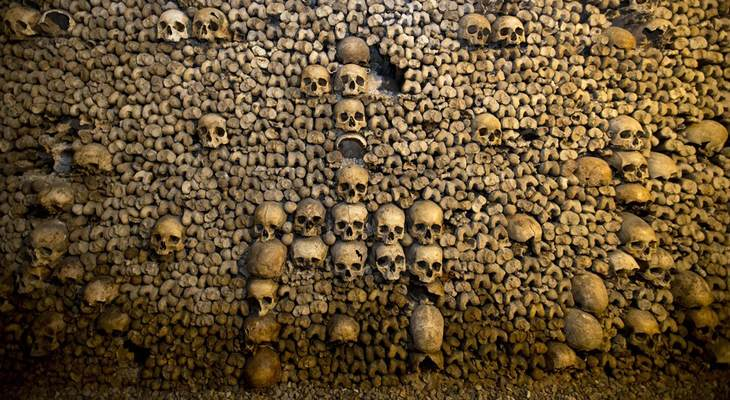 In this photo taken Tuesday, Oct. 14, 2014, skulls and bones are stacked at the Catacombs in Paris, France. The subterranean tunnels, stretching 2 kilometers (1.24 miles), cradle the bo