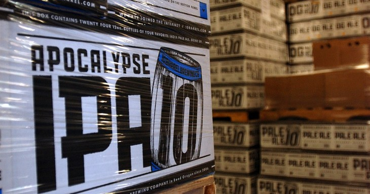 In this Nov. 18, 2014 photo, cases of Apocalypse IPA from 10 Barrel Brewing Co. await shipment in Bend, Ore. As it grew from a struggling timber town to an outdoor recreation destinatio
