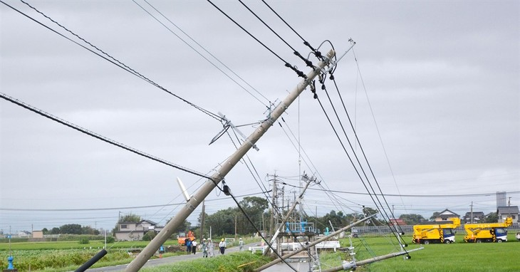 Telephone poles lean after Typhoon Goni hit Kamimine town, Saga prefecture, southwestern Japan, Tuesday, Aug. 25, 2015. The powerful typhoon damaged buildings, tossed around cars and fl