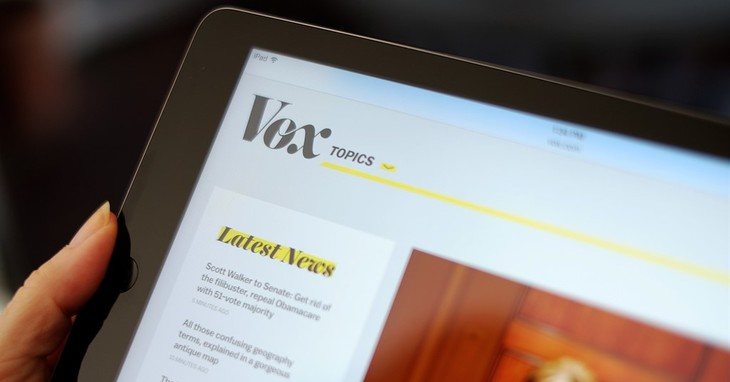 The Vox website is displayed on an iPad held by an Associated Press staffer in Los Angeles, on Tuesday, Sept. 1, 2015. Comcast, which became a TV powerhouse by signing up Generation Xer