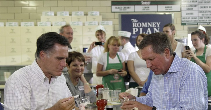 FILE – In this Aug. 14, 2012, file photo, former Massachusetts Gov. Mitt Romney, the presumptive Republican presidential nominee, eats ice cream with Ohio Gov. John Kasich at Tom's Ice