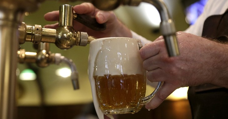 A bartender fills a glass of beer at a pub in Prague, Czech Republic, Tuesday, Feb. 2, 2016. Czech republic's Finance Minister Andrej Babis is proposing to cut the value added tax on dr