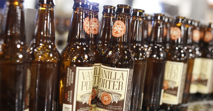 In this Thursday, Jan. 21, 2016, photograph, bottles of beer head to be filled on line in the factory of Breckenridge Brewery in Littleton, Colo. Independent brewers in Colorado's boomi