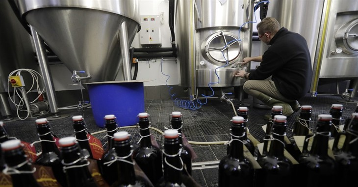 In this picture taken on Tuesday, Dec. 6, 2016, master brewer Jiri Kratochvil fills a glass with beer at a brewery located inside a 12th century complex of the Zeliv monastery in Zeliv,